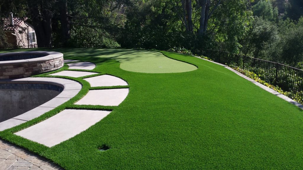 Personal putting green-Tampa Bay FL Outdoor Living & Designs-We offer Landscape Design, Outdoor Patios & Pergolas, Outdoor Living Spaces, Stonescapes, Residential & Commercial Landscaping, Irrigation Installation & Repairs, Drainage Systems, Landscape Lighting, Outdoor Living Spaces, Tree Service, Lawn Service, and more.